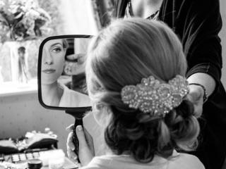 Low bun wedding hairstyle pearl comb